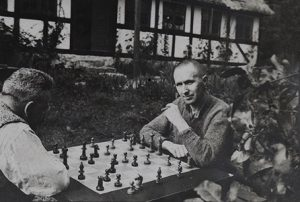 Photographic portrait of Bertolt Brecht playing chess