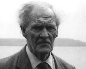 Photograph of a scowling R. S. Thomas