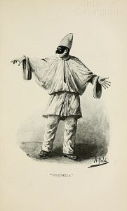 Pulcinella in his white robes and hat, and black, hook-nosed mask